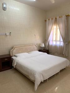 A bed or beds in a room at Al Shraija Castle , Al Jabal Al Akhdar