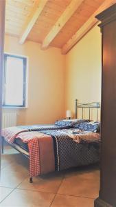 Letto o letti in una camera di Residence La Sorgente