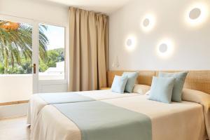 Uma cama ou camas num quarto em San Miguel Park / Esmeralda Mar