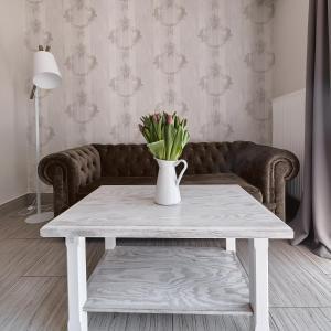 A seating area at Apartamenty Górska Legenda