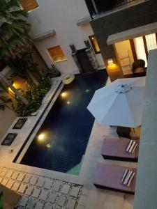 A view of the pool at The Oasis Retreat Seminyak or nearby