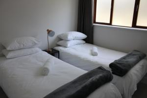 A bed or beds in a room at Castleton Plettenberg Bay
