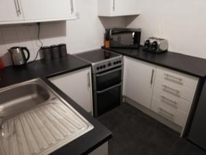 A kitchen or kitchenette at River Nene Cottage