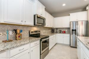 A kitchen or kitchenette at 8 Bedroom, 6 Bathroom Upscale Villa Near All The Fun in Kissimmee