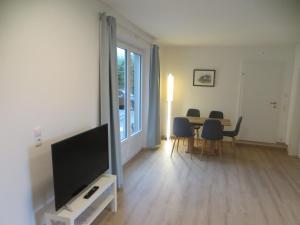 TV/Unterhaltungsangebot in der Unterkunft City Apartment Amadeus