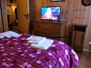 Letto o letti in una camera di Relax Cinque Confini