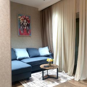 A seating area at Apartments - Mari`El