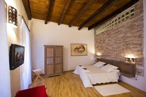 Letto o letti in una camera di Castelletto Suites