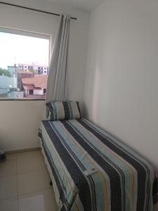 Cama o camas de una habitación en Apartamento a 350m da Orla de Atalaia