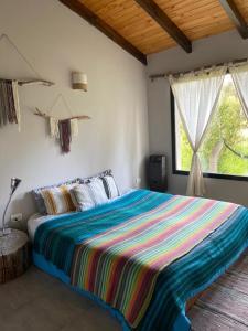 Una cama o camas en una habitación de Casa nomade