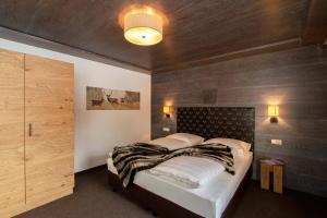 Ein Bett oder Betten in einem Zimmer der Unterkunft Gurglhof Apartmenthaus