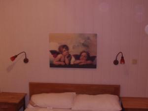 Ein Bett oder Betten in einem Zimmer der Unterkunft Halmis FeWo