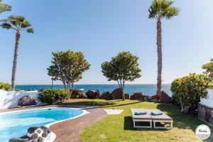 Het zwembad bij of vlak bij Kamezí Boutique Hotel Villas