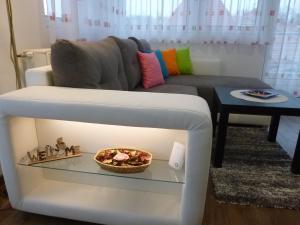 A seating area at Zsuzsa Apartman Hévíz-Centrum