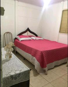 A bed or beds in a room at Nosso Cantinho