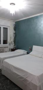 A bed or beds in a room at VENICE NIGHT NEAR TRAIN STATION