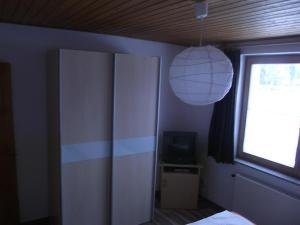 A television and/or entertainment center at Apartman Nóra