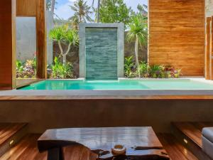 The swimming pool at or close to Batatu Villas