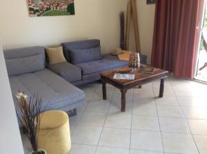 Ein Sitzbereich in der Unterkunft Sofia Menigos Apartments No 20