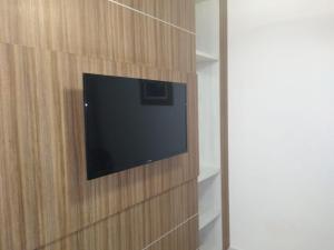 A television and/or entertainment center at Apartamento Diroma Lacqua 3