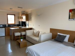 A seating area at Bay Apartments Sozopol