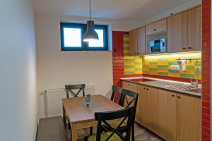 A kitchen or kitchenette at Apartments Helena Kranjska Gora