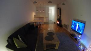 A television and/or entertainment centre at Apartment SlopeStyle Bjelasnica