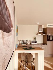 A kitchen or kitchenette at LUXURY APARTMENT MONS CITY Centre
