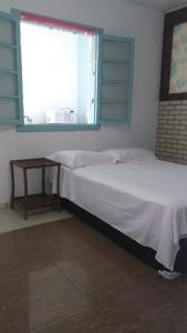Cama o camas de una habitación en Apartamento Completo Privativo