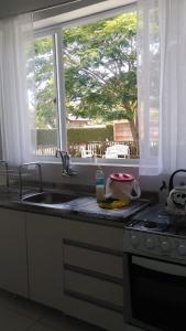Una cocina o zona de cocina en Apartamento Completo Privativo