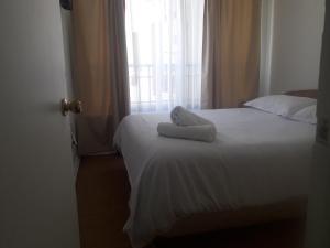 Cama o camas de una habitación en Depto Metro La Moneda
