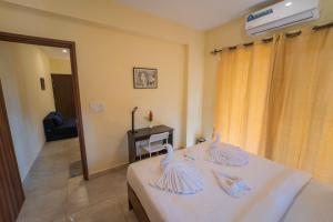 A bed or beds in a room at Mariners Bay Suites