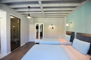 斯科普里拱門鄉村民宿房間的床