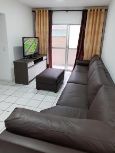 A seating area at Apartamento 2700 Camboriu