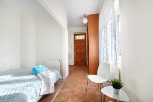 Ein Bett oder Betten in einem Zimmer der Unterkunft Váci170 Apartman