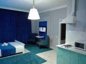 A kitchen or kitchenette at Bon Mary Apart Hotel