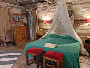A bed or beds in a room at Le Cabanon