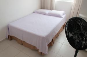 Cama o camas de una habitación en Residencial Porto Caravelas