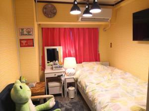 賃貸naviホステルにあるベッド
