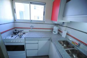 Una cocina o kitchenette en AcarSuites II