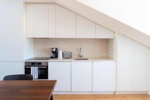 A kitchen or kitchenette at Feels Like Home Martim Moniz Trendy Flat