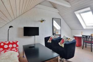 Et tv og/eller underholdning på Klitbakken Apartment