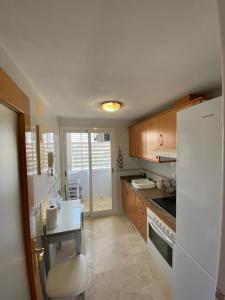 A kitchen or kitchenette at Luxury Apartament Levante Beach