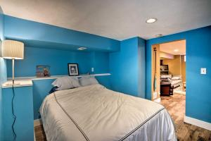 A bed or beds in a room at Sunnyside Apartment 3 Mi. to Downtown Denver!