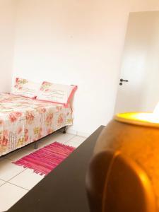 A bed or beds in a room at Apartamento Praia de Iracema