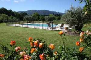 The swimming pool at or close to Le Moulin de Felix