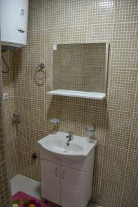 A bathroom at Apartmani ELITE