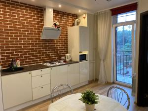 A kitchen or kitchenette at Аpartments in the center of Svetlogorsk-2