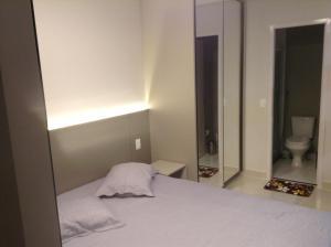 A bed or beds in a room at Flat mobiliado de luxo perto do Goiania Shopping