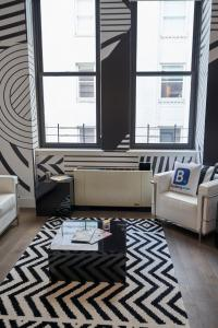 A seating area at Resolution Suite: Be More Active